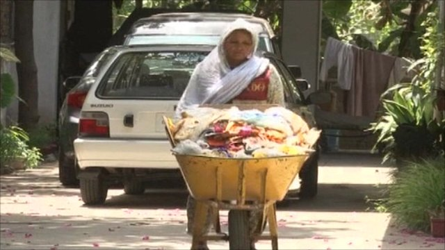 A Christian woman sweeps the streets of Pakistan
