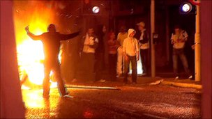 Youths rioting in front of fire
