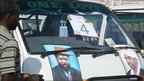 Vehicle displaying pictures of President Omar al-Bashir (l) and the southern president, Salva Kiir (r)