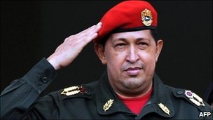 Hugo Chavez salutes the crowd from the balcony of the presidential palace in Caracas, Venezuela 4 July 2011