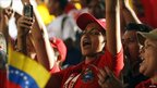 Supporters of Venezuela&#039;s President Hugo Chavez cheer in front of the president&#039;s Miraflores Palace in Caracas, Venezuela, 4 July 2011