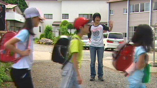 Yukie Kawamura sends her children to school