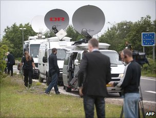 Media crews in the Danish town of Padborg, on the German border, 5 July