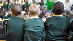 Three schoolboys in an assembly