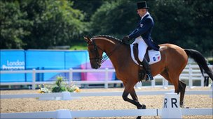 Denis Mesples of France competing in the dressage event