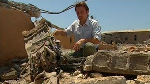 The BBC's Rupert Wingfield-Hayes with the remains of a Russian ejector seat at an alleged Nato bombing site in Libya