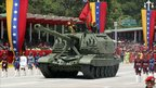 An armoured vehicle leads Venezuela's independence day parade - 5 July 2011