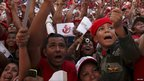 Supporters of President Hugo Chavez react to his speech from the presidential palace - 4 July 2011