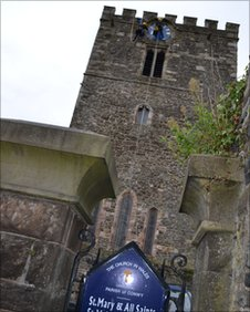 Clock restorers at Conwy