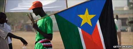 A man holds the new flag of South Sudan
