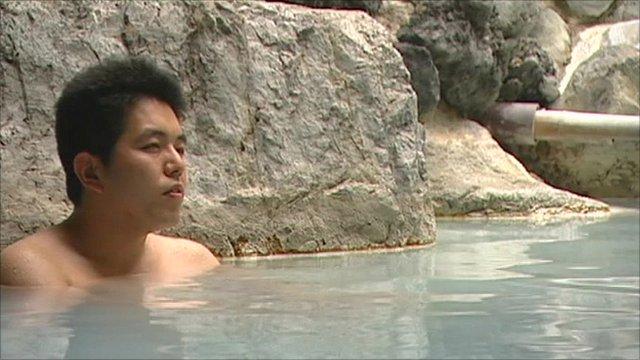 Man sat in a hot spring in Japan