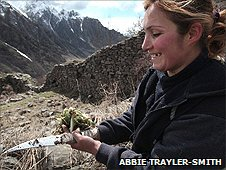 Woman digging for roots in Armenia