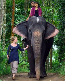 Laura Puukko with an elephant in Kerala