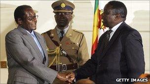 Robert Mugabe and Morgan Tsvangirai shake hands (archive photo)
