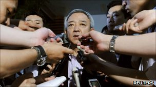 "Ryu Matsumoto is surrounded by reporters at the prime minister""s official residence in Tokyo, Japan, Monday, June 27, 2011"
