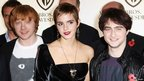 Rupert Grint, Emma Watson and Daniel Radcliffe attend a Warner Bros photocall held at Claridges on November 10, 2010 in London, England