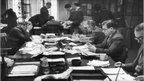 News subs work on the constant influx of copy in the newsroom of the News of the World newspaper on Fleet Street, 18 April 1953