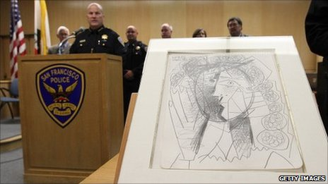 San Francisco police chief Greg Suhr speaks next to the recovered Picasso drawing.