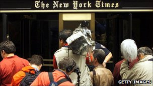 Reporters standing outside of the New York Times building in New York City in 2003