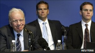 Media baron Rupert Murdoch (L) with his sons Lachlan (C) and James attend a News Corp annual general meeting in Adelaide - 9 October 2002