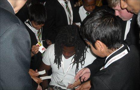 Ade Adepitan signing autographs