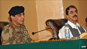 "Pakistan""s army chief Ashfaq Parvez Kayani (L) and Prime Minister of Pakistan Yousuf Raza Gilani (R) attend the national seminar on de-radicalisation in Mingora on July 6, 2011."