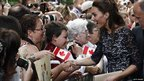 The Duchess of Cambridge greets spectators during an official welcoming ceremony at Rideau Hall in Ottawa, Canada