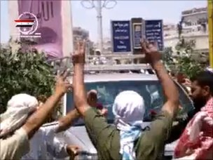 A 4x4 vehicle purportedly carrying US ambassador Robert Ford drives through Assi Square in Hama