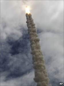 Atlantis disappearing into the clouds