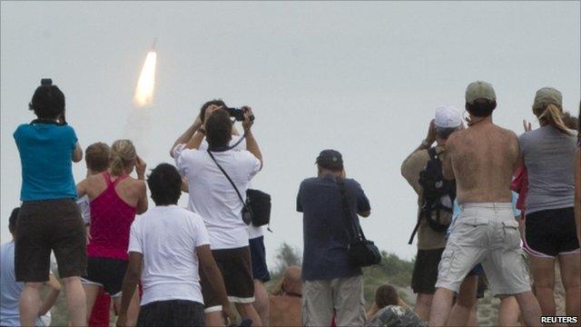 Spectators watch shuttle launch from Florida coast