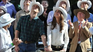 Prince William and his wife Catherine, Duchess of Cambridge, push a plunger to officially start the Stampede parade in Calgary