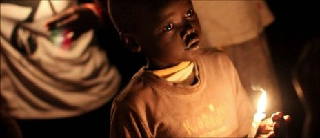 A South Sudanese boy holds a candles at midnight on 9 July 2011 to mark the day that South Sudan became independent
