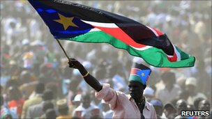 A man waves South Sudan's national flag as he attends the independence day celebrations in the capital Juba, 9 July 2011