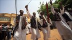 Members of the Platform of Peace and Justice perform with swords to celebrate the secession, Khartoum, 9 July