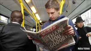 A man reads NoW on the bus