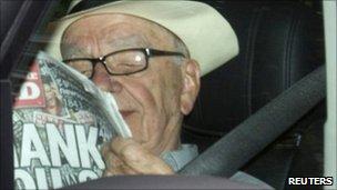 Rupert Murdoch arrives, reading the News of the World
