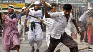 Islamist activists armed with sticks chase anti-strike supporters during a 30-hour nationwide strike in Bangladesh on 10 July 2011