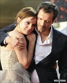 Producer David Heyman hugs actress Emma Watson