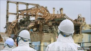 Officials inspect the damaged building housing the No.3 reactor at Fukushima Daiichi nuclear power plant on June 17, 2011
