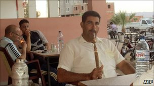 Tunisians smoke sheesha in a cafe in Sidi Bouzid, June 2011