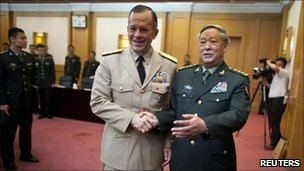 Admiral Mike Mullen (L) shakes hands with General Chen Bingde before their meeting at the Bayi Building in Beijing July 11, 2011