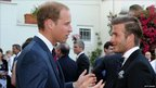 Prince William, Duke of Cambridge, speaking to David Beckham