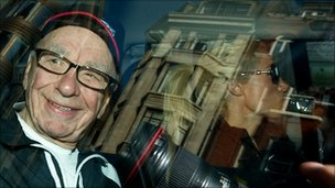 Rupert Murdoch leaves his London flat on Monday