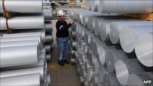 A workers checks stocks of aluminium at Alcoa's plant in Portovesme on the Italian island of Sardinia