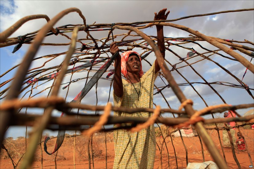 Nado Mahad Abdilli builds a makeshift shelter for her family in Iffou 2