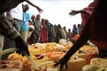 Recently-arrived Somali refugees wait to fill jerry cans with water at a newly-installed tank in Iffou 2