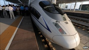 A high-speed train arrives at the Bengbu station, east China's Anhui province, one of the stops of the Beijing to Shanghai line which was launched on 30 June 2011