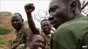 Soldiers of Sudan People's Liberation Movement's northern arm drive through the Nuba mountains of South Kordofan on 29 June 2011