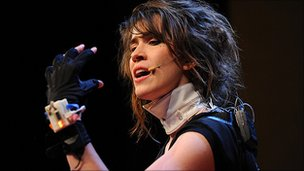 Imogen Heap wearing the gloves. Copyright James Duncan Davidson