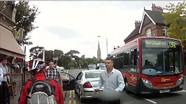 The attacker emerges from his car to assault Simon Page
